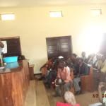 1 childline staff demonstrating hand washing at Busimbi community hall (3)